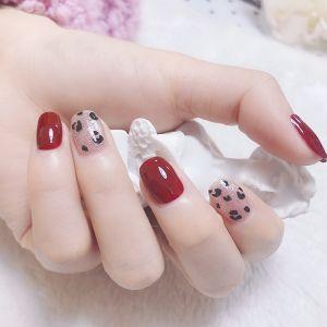 红色手绘猫眼美甲图片